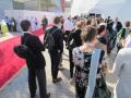 Two busloads of visitors file into the outdoor tent to hear the opening presentations.