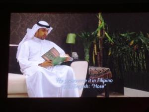 Alsanousi reading from his novel during the short film.