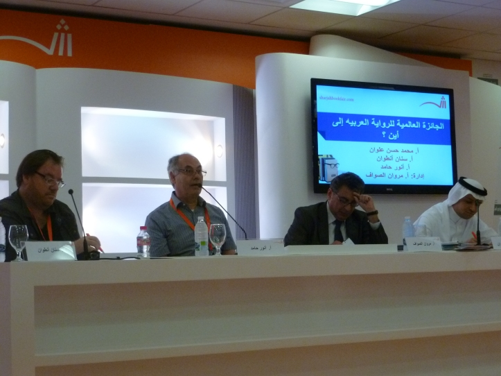 Sinan Antoon, Anwar Hamed, and Mohammad Hassan Alwan speaking at the Sharjah International Book Fair. Photo credit: Kate Kasimor.