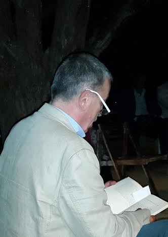 Douaihy reading from his novel.