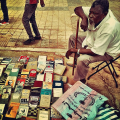 Man at the Mafroosh used book market. Photo: Khalid Albaih. Creative Commons license.