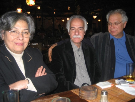 With her husband Mourid Barghouti and Moroccan poet Abdellatif Laâbi.