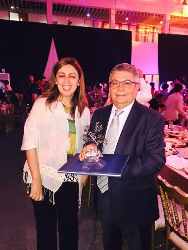 The author accepts the award with publisher Balsam Saad. Photo: Amira Aboulmagd.