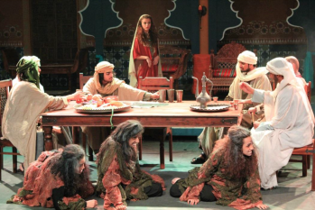 American University of Sharjah performance of Macbeth in Arabia: Banquet scene at Macbeth's castle, with the three witches under the table. Photo by Zuzana Tassa, courtesy of director Anthony Tassa.